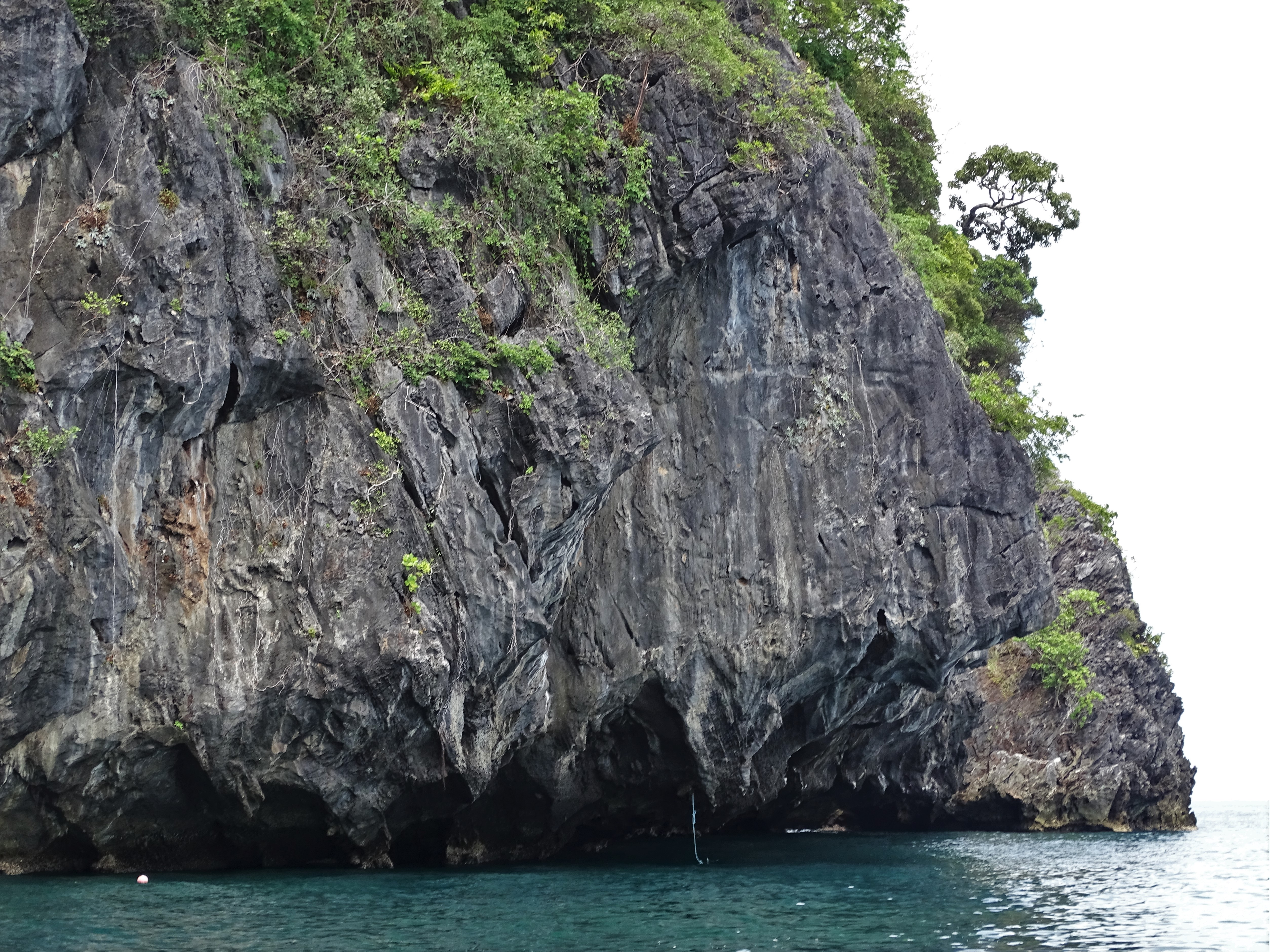 the rock in the sea:  Emerald cave is on the other side