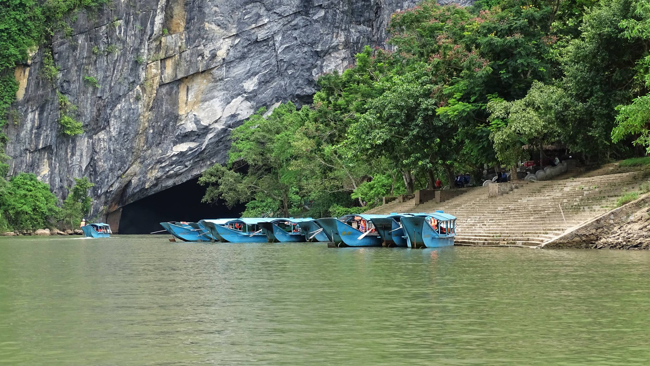 Boats moored at the entrance to Phong Nha Cave, located directly on the river