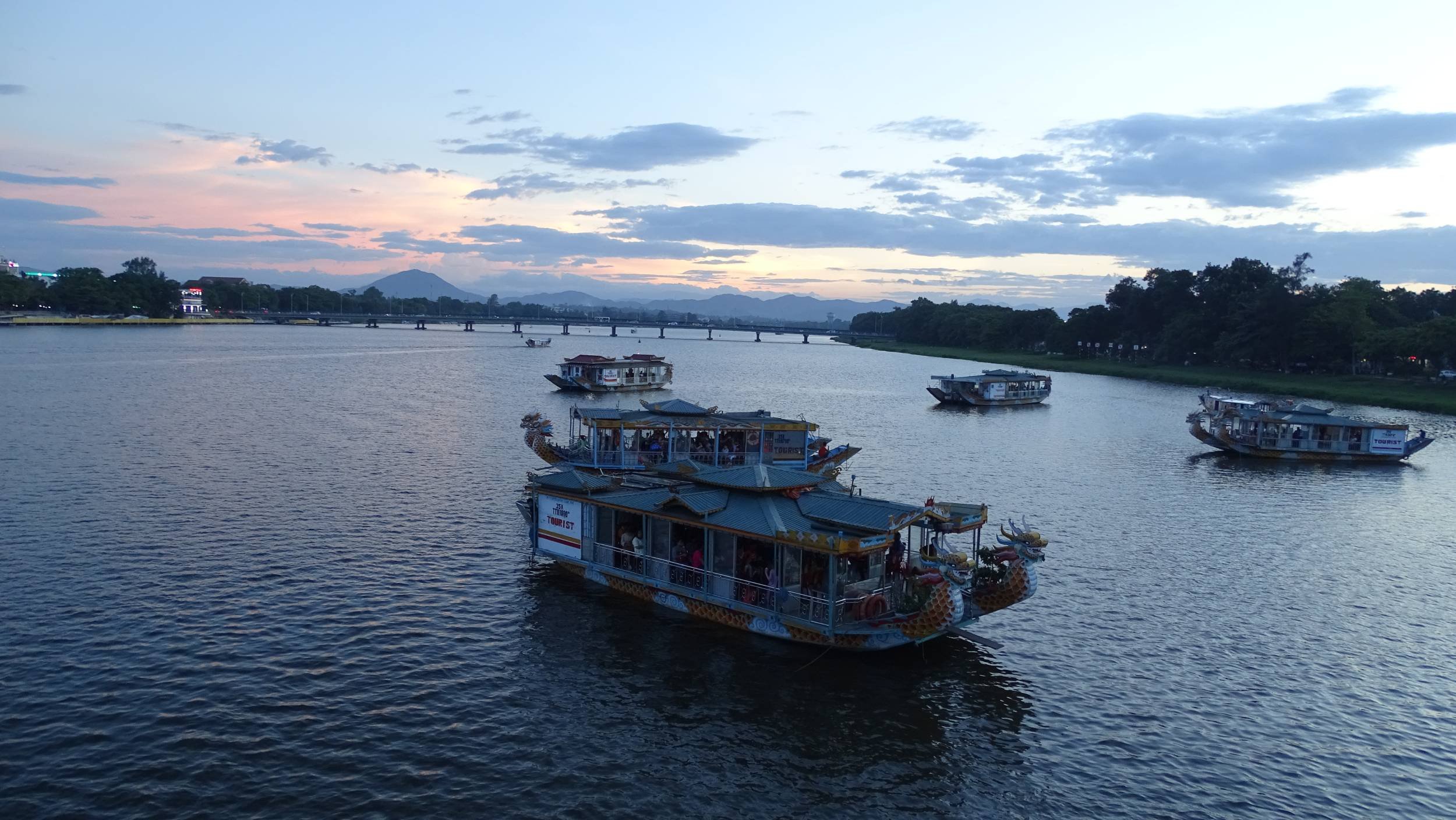 Tourists boats on the Perfume River in Hue around sunset