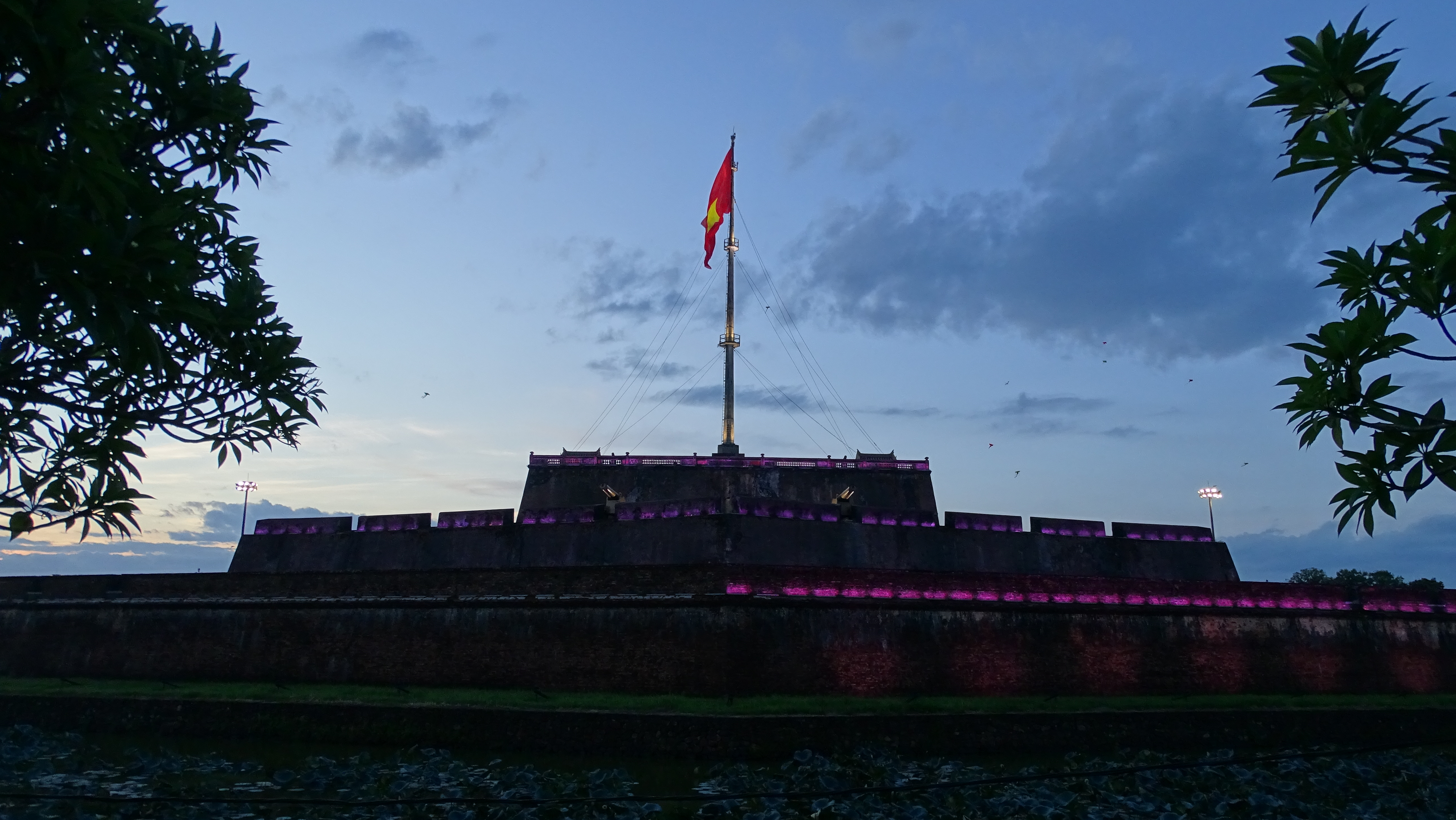 The  enormous flagpost at the Hue citadel at night