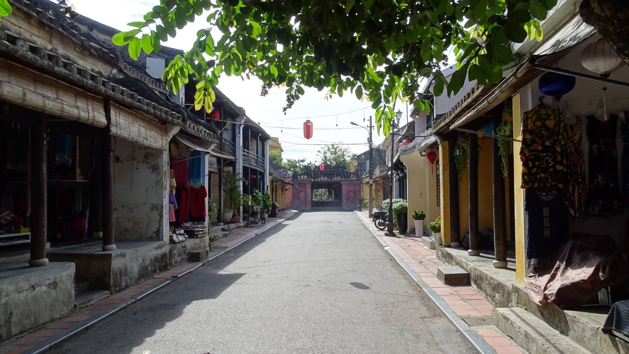 Empty street lined with old houses leading to the covered Japanese Bridge