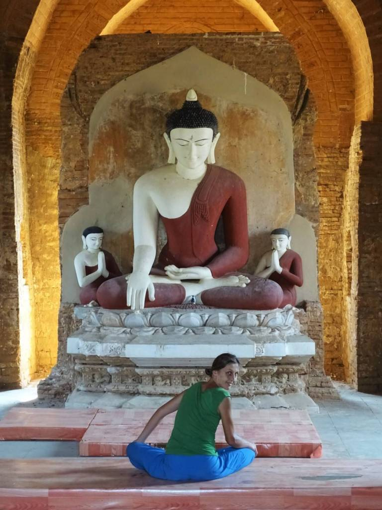 The author turns round from a cross-legged position when sitting in front of a Buddha statue inside one of the temples in Bagan, Myanmar