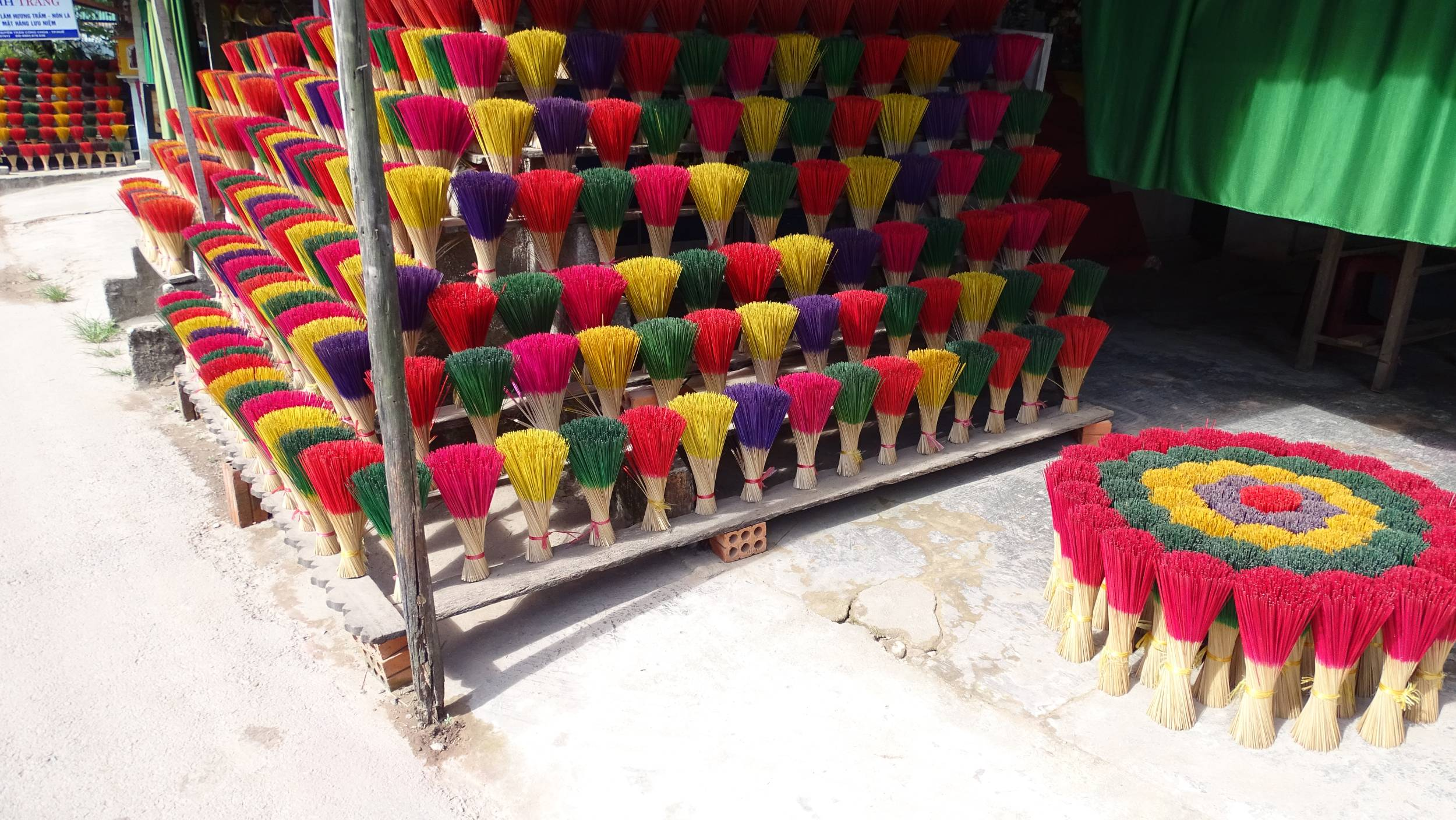 A stall with bundles of colourful incense sticks