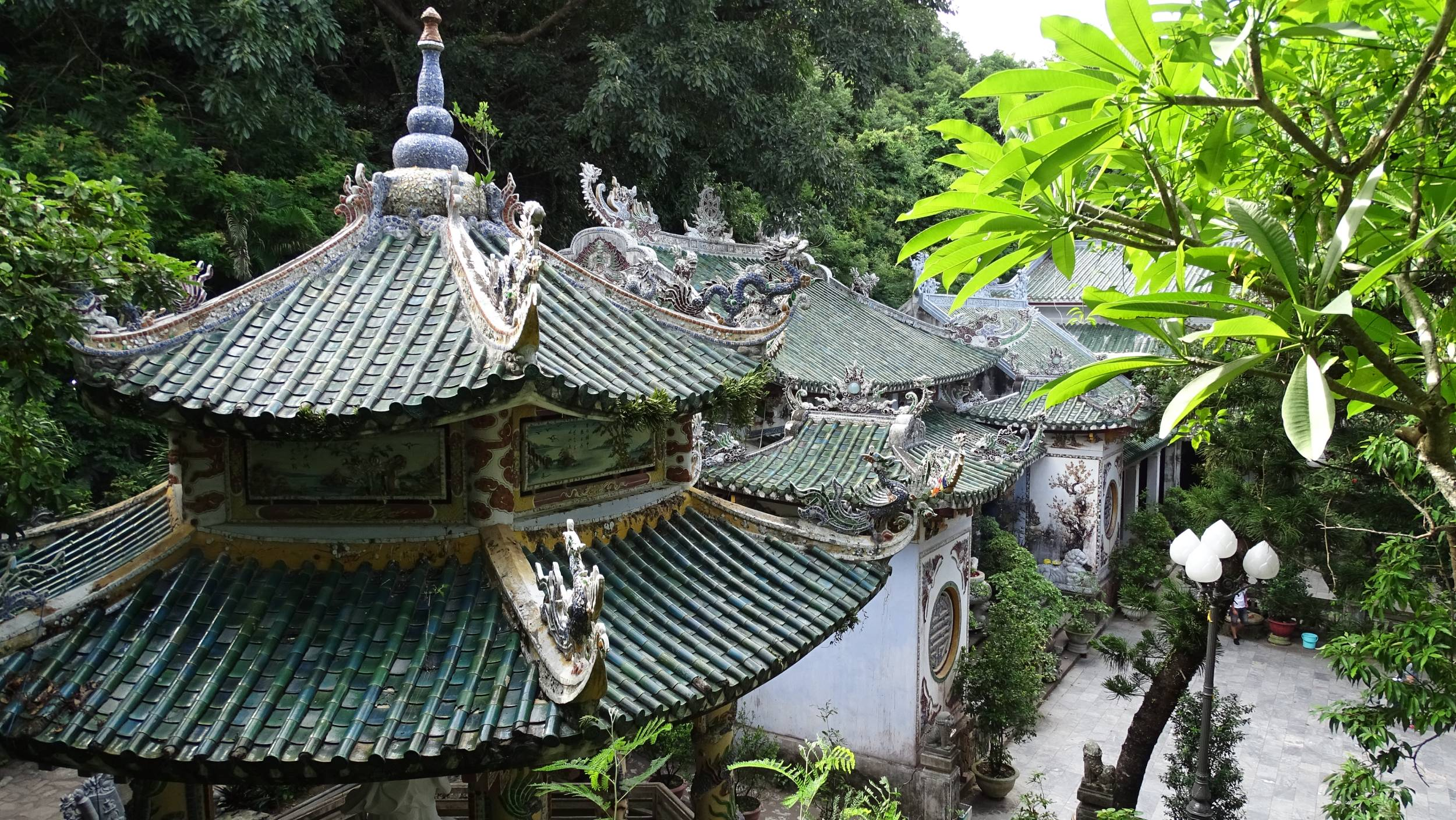 The green tiled roof of the Linh Ung Pagoda at the Water Mountain