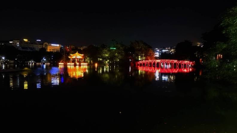 Hoan Kiem lake at night with illuminated red bridge and Ngoc Son temple