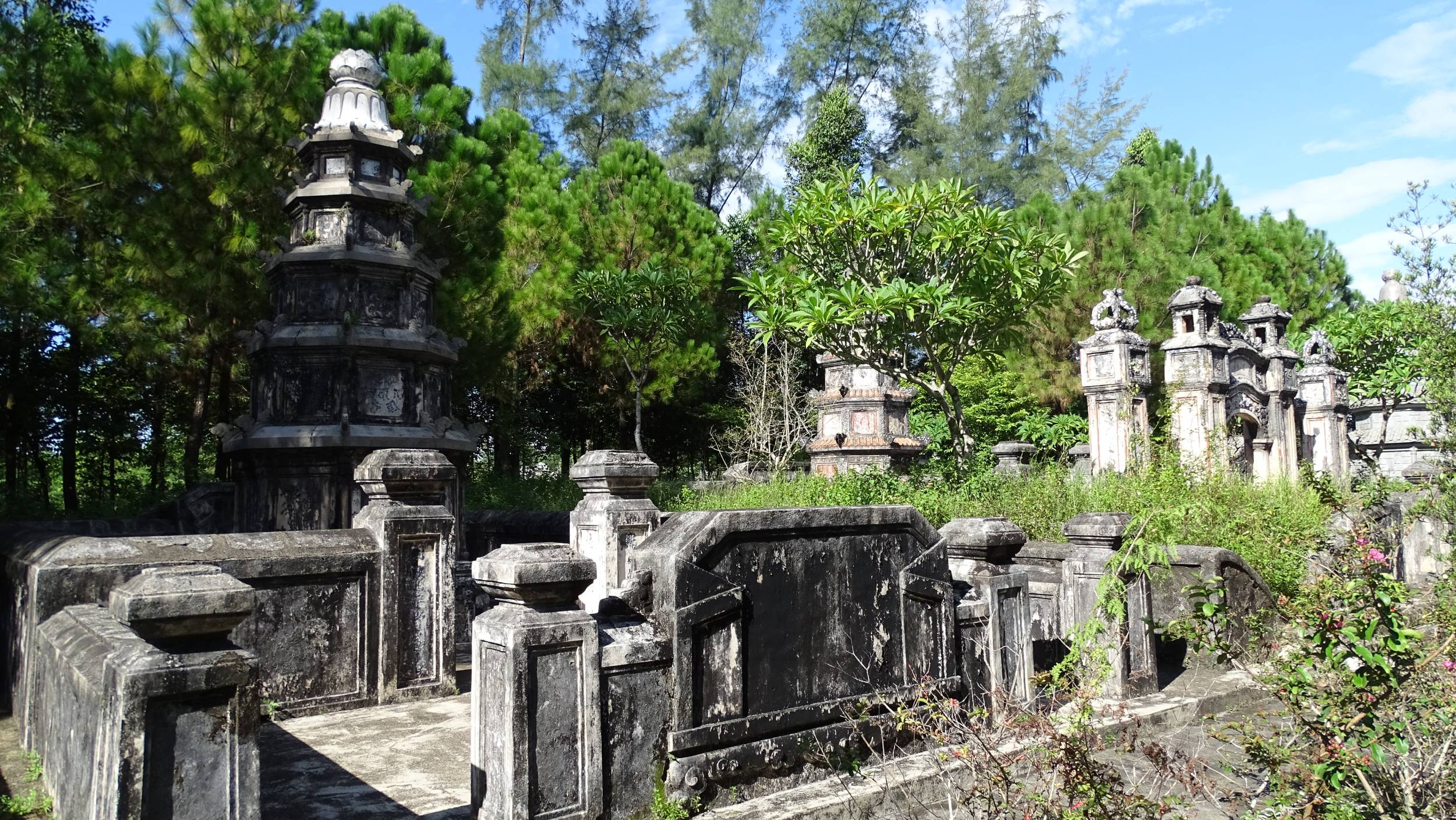 An old cemetery covered with forest on the way to Tu Duc tomb in Hue