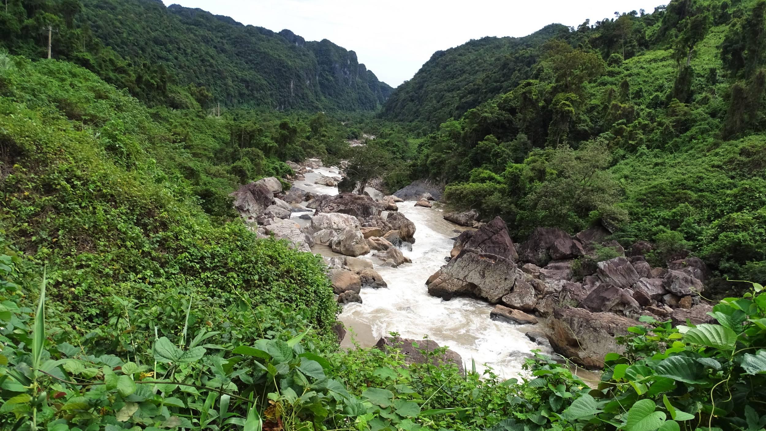 Mountain river flowing through the lush green landscape of Phong Nha Ke Bang National Park
