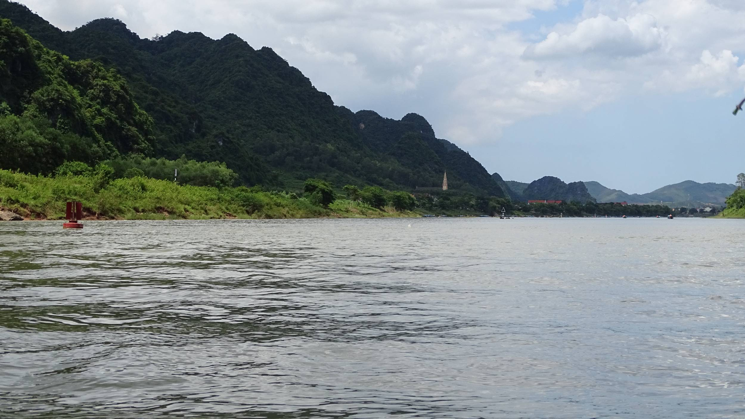 The view of the river and the karst landscape on the boat ride towards Phong Nha Cave