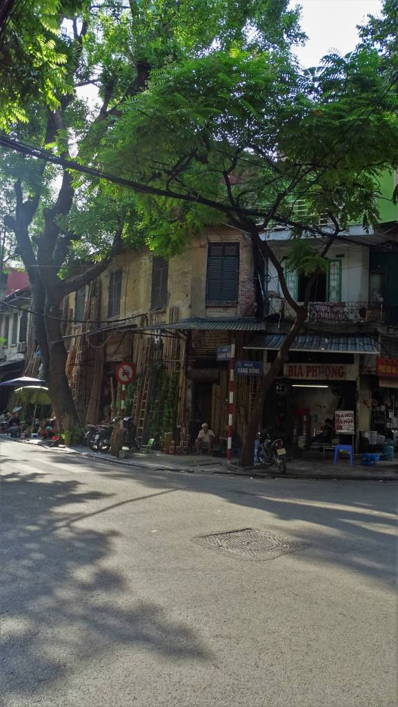 Bamboo scaffolding propped against an old house in the Old Quarters of Hanoi
