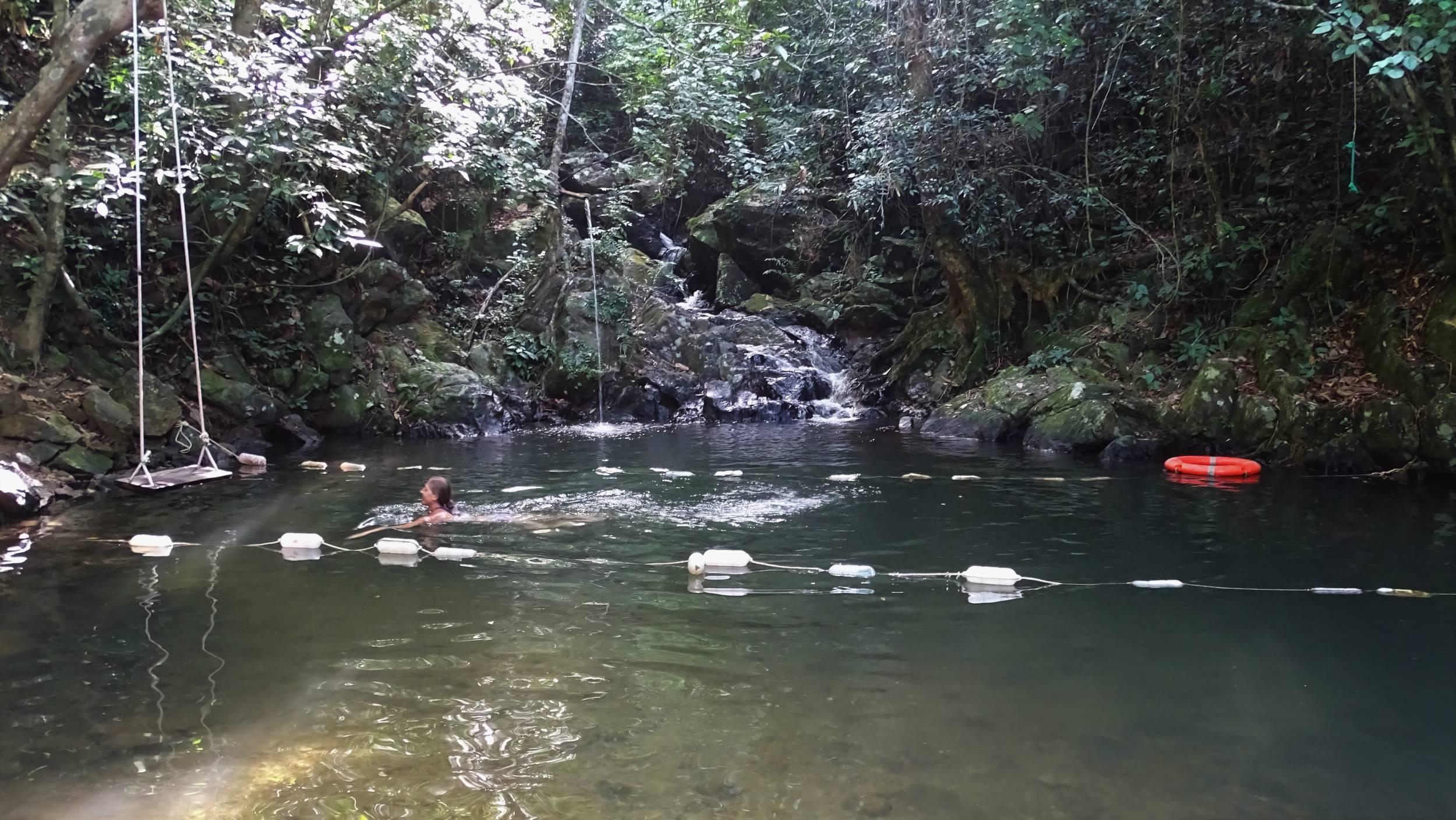Swimming in a small waterhole on a stream inside Phong Nha Ke Bang National Park