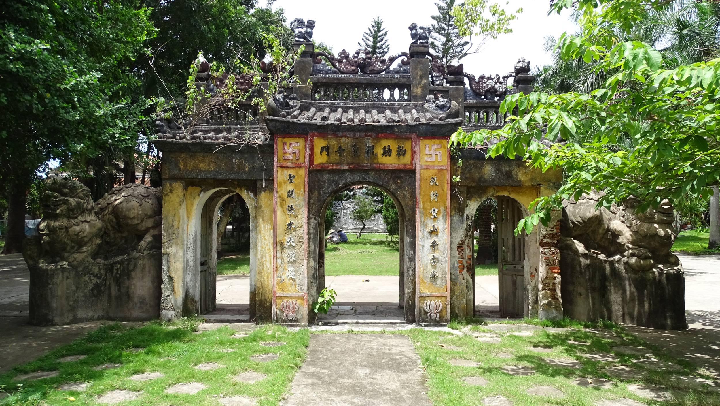 A triple gate leading to a temple in Tan An area of Hoi An