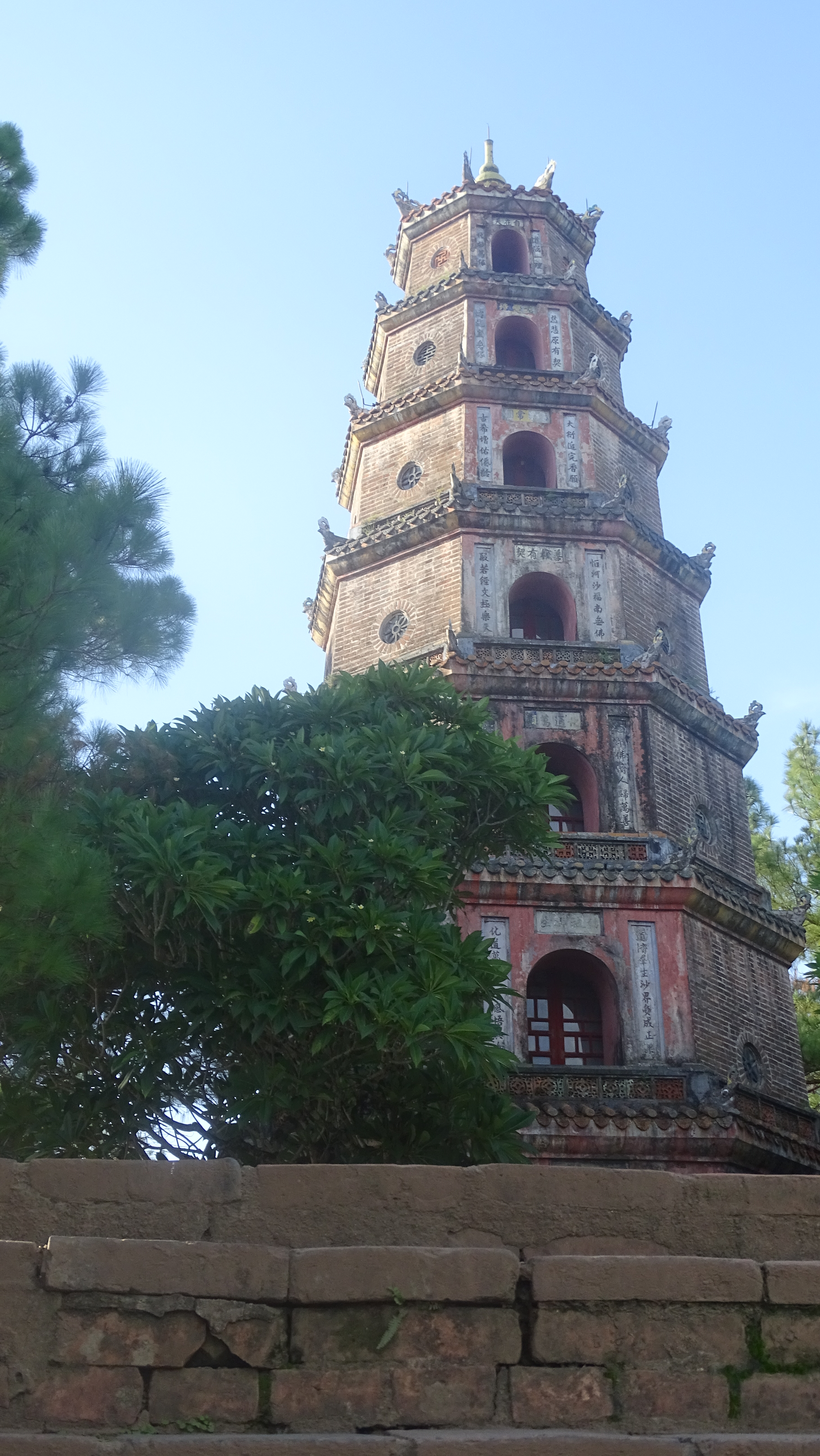 Seven-tiered, red-brick tower of Thien Mieu pagoda at the backdrop of blue sky