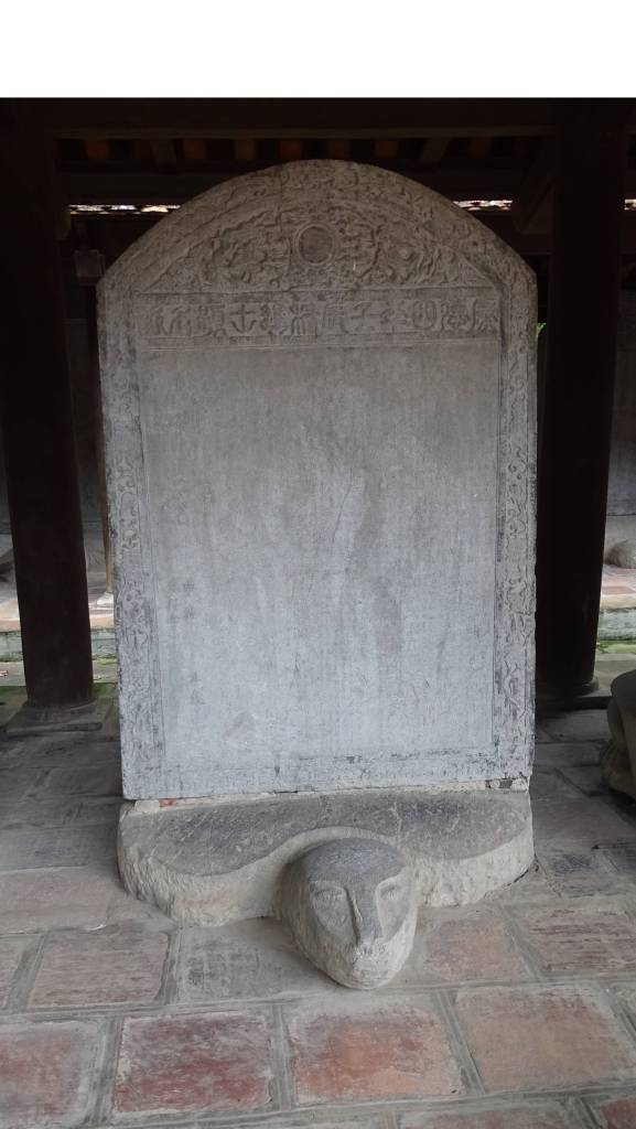 A stone turtle carrying a stela with the names written in Chinese characters