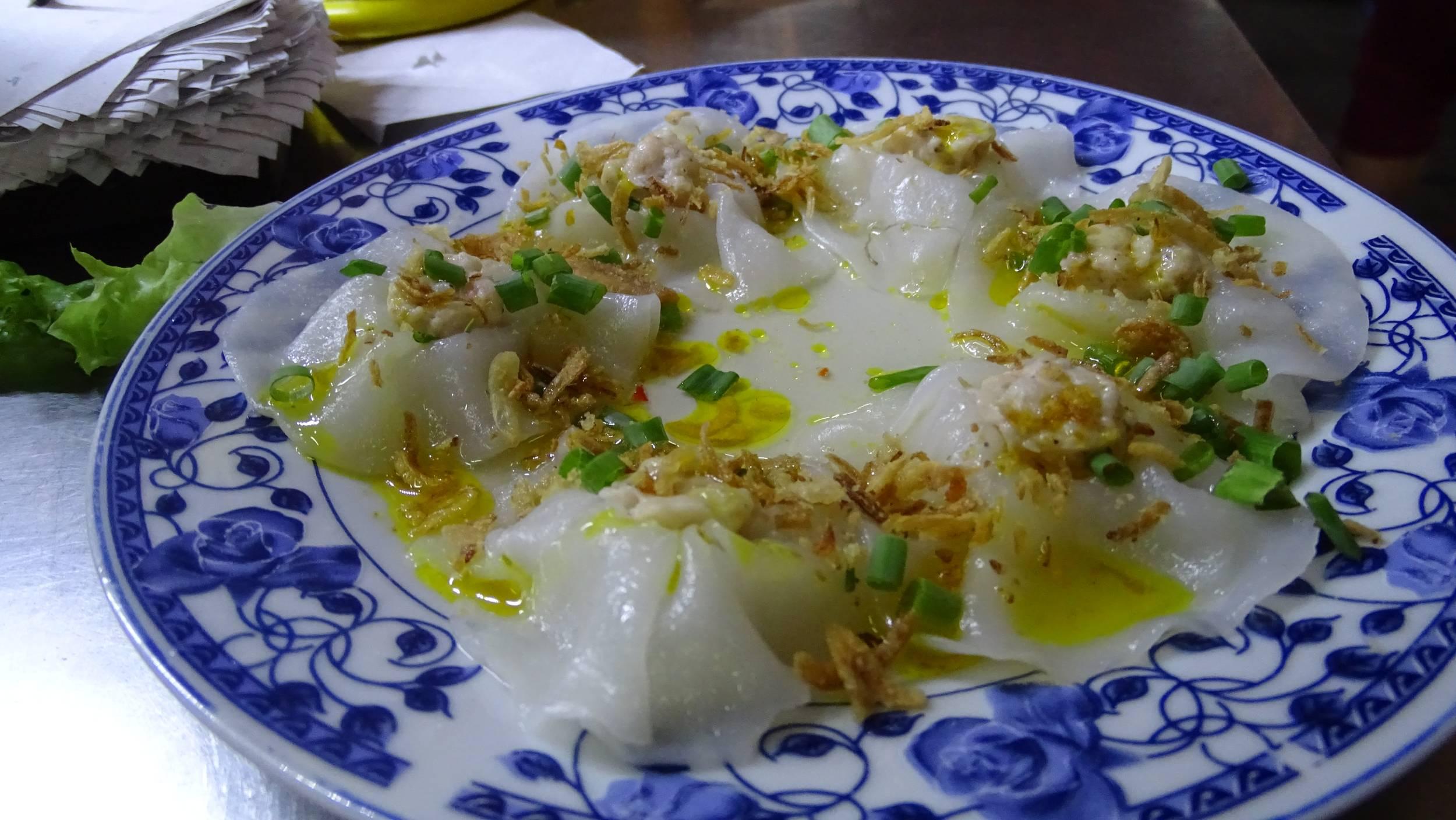 Vietnamese rice flour dumplings served on a china plate