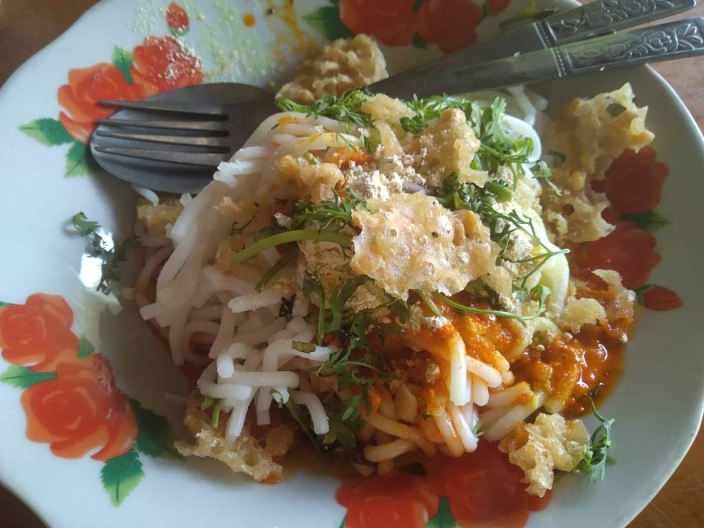 Burmese Shan noodles- rice noodles with a red sauce and crispy deep fried topping