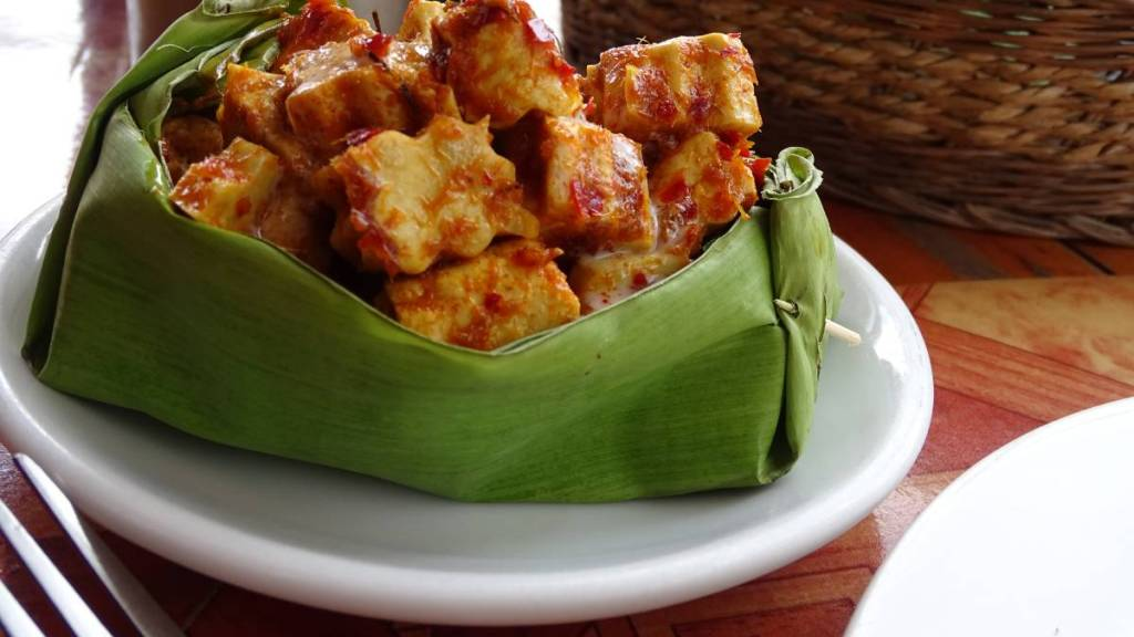 Marinated tofu cubes served in a banana leaf - a vegan version of Khmer amok dish
