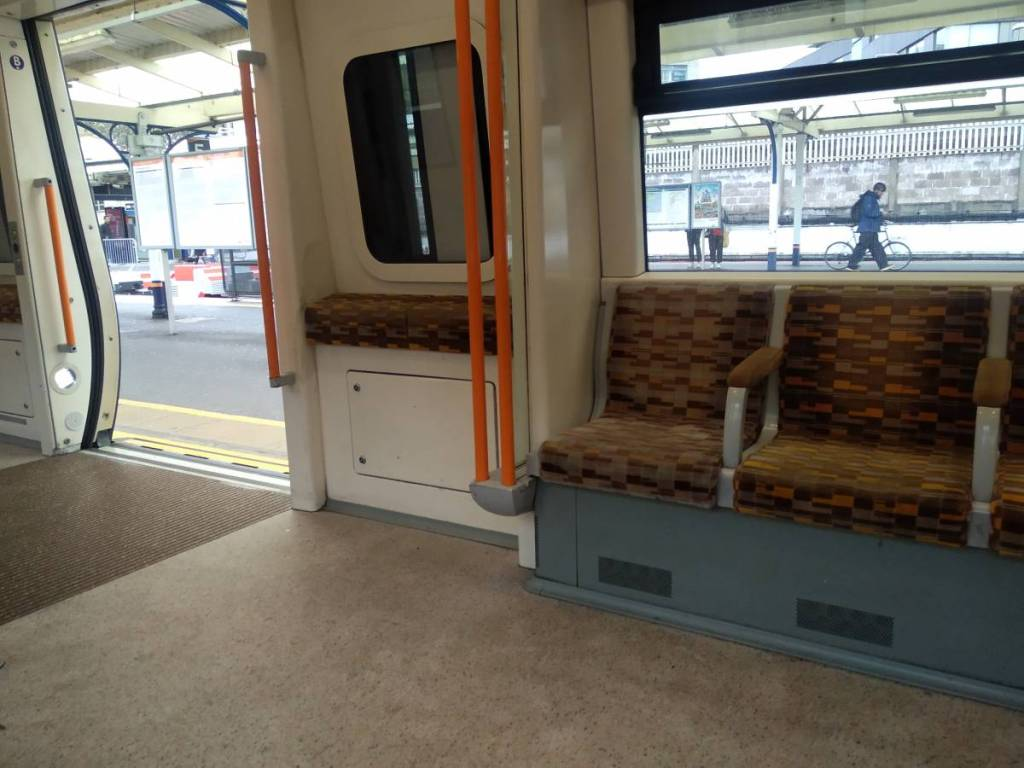 The empty interior of the overground suburbian train in London, standing at the platform