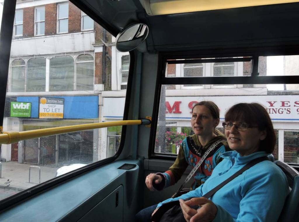 Author and her mum looking through the front window of the top level of a London double-decker