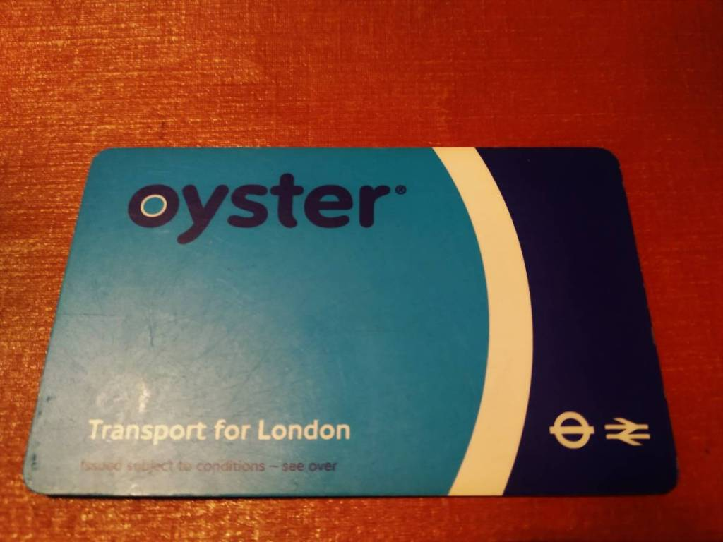 A plastic, blue Oyster card - a London travel card