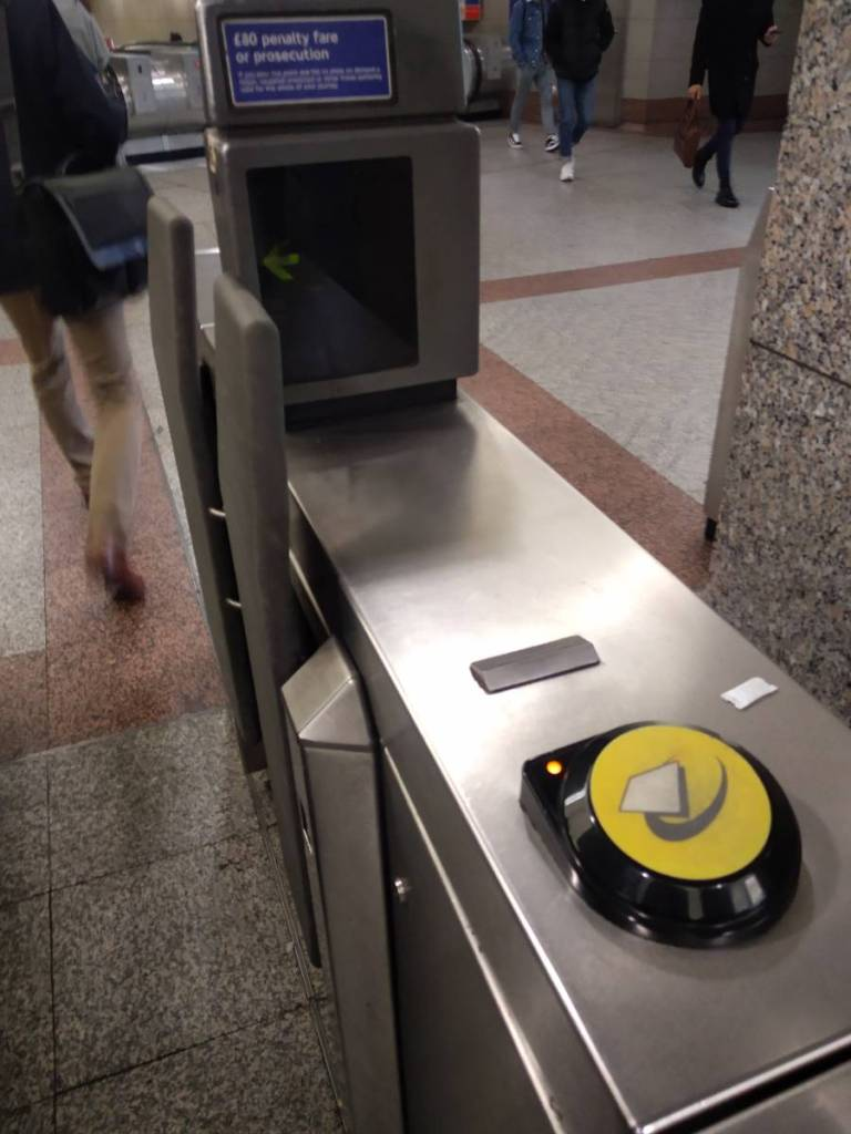 Yellow card reader at the gate on London tube