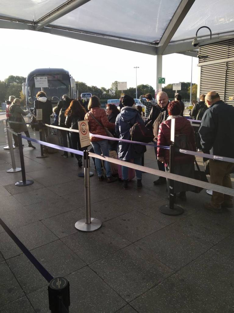 A queue to take a coach from Stansted Airport to the centre of London