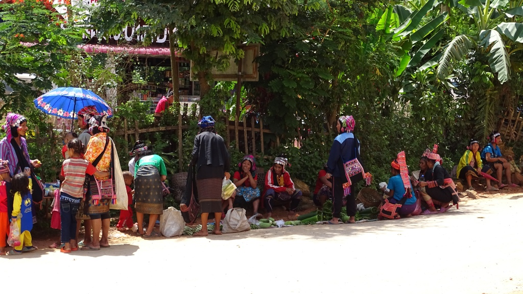 A row of female vendors and buyers from Akha Puli ethnic minority of northern Laos