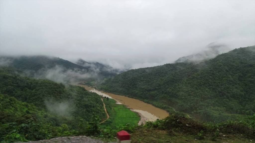 A view from the road between Dien Bien Phu in Vietnam and Muang Khua in Laos: steaming forested hills and muddy Nam Ou river