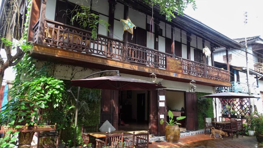 An old two-storied wooden house with a veranda turned into a guesthouse , Luang Prabang