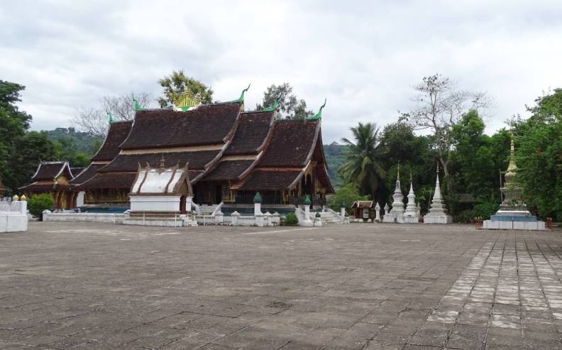 An old temple (wat) in Luang Prabang with characteristic, many-tiered roof