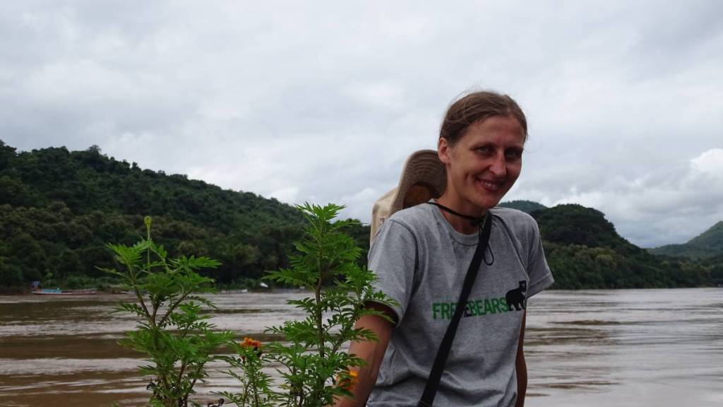 I'm  wearing a 'Free the bears'  T-shirt from the Bear Rescue Centre in Luang Prabang while posing to a photo on a ferry across the Mekong