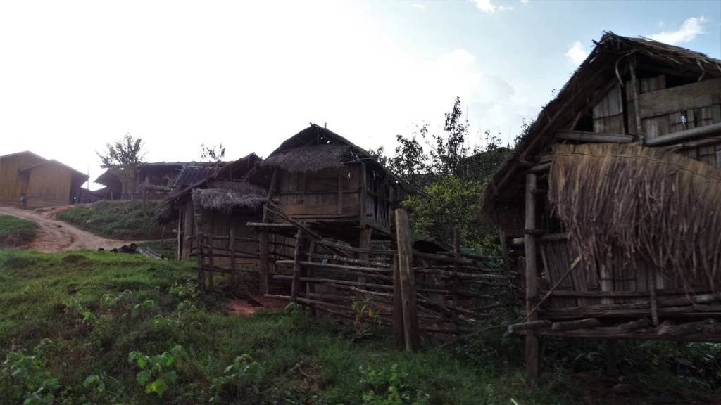 A tiny Laotian village consisting of wooden houses on stilts
