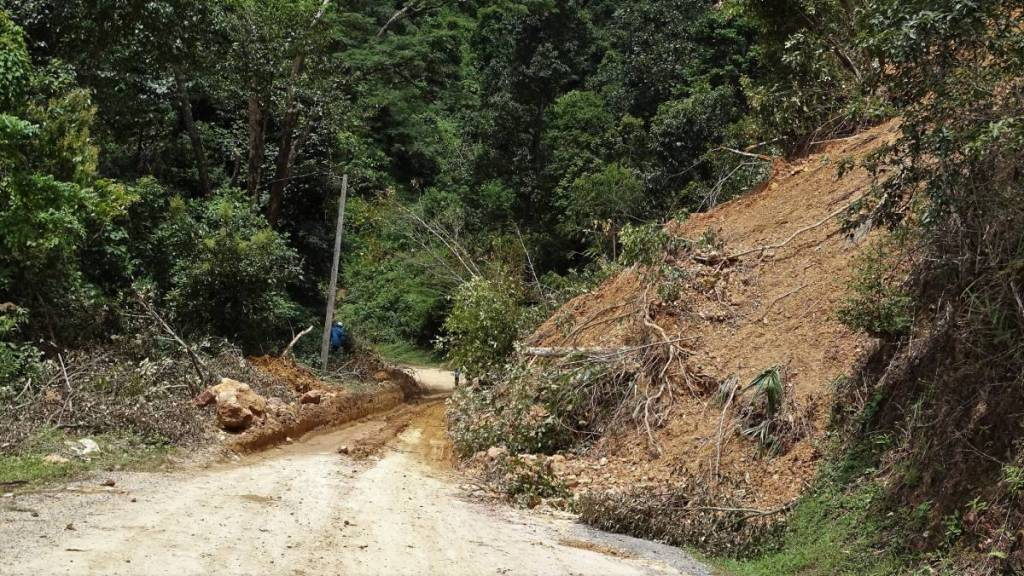 A landslide encroaching on the road on the route to Sam Neua