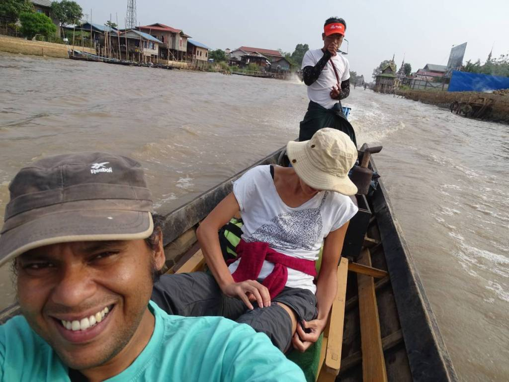 Authors and a guide- driver on a narrow tourist boat in Myanmar