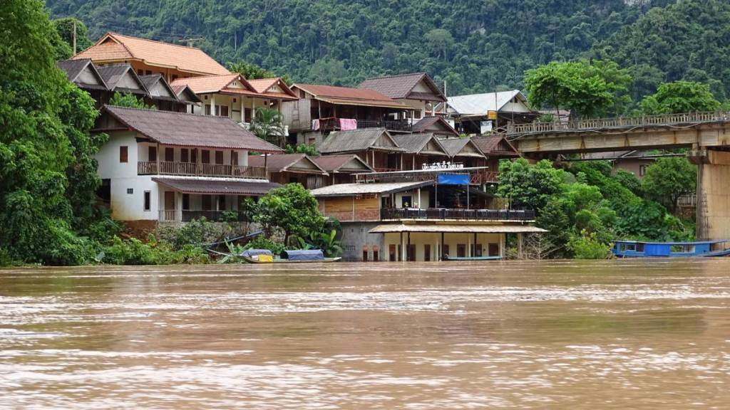 Guesthouses in Nong Khiaw partially submerged by the river
