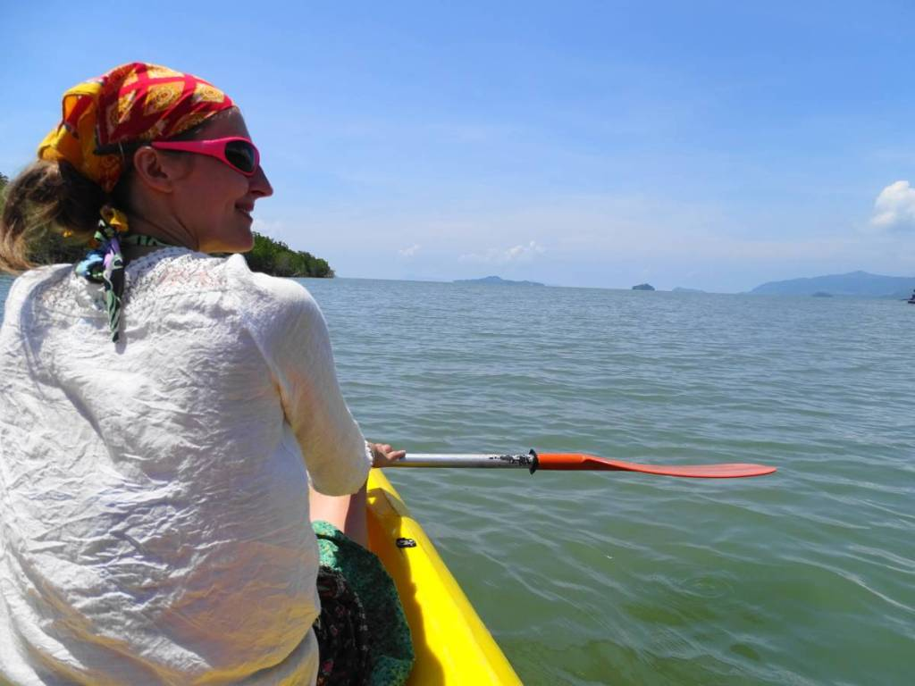 Author enjoying the views of the sea and islands in the distance from a yellow kayak