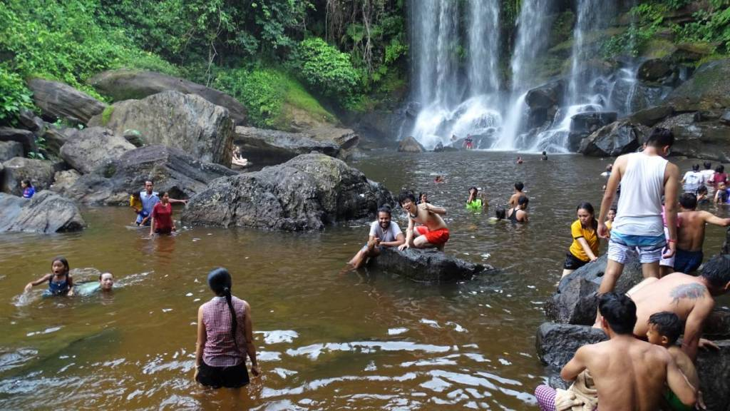 Khmer men and women having a bath clothed at the Phnom Kulen waterfalls