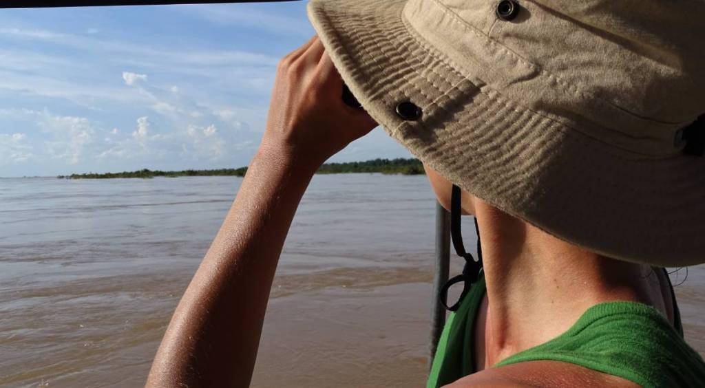 The author looking at the Mekong river from a boat in Kratie