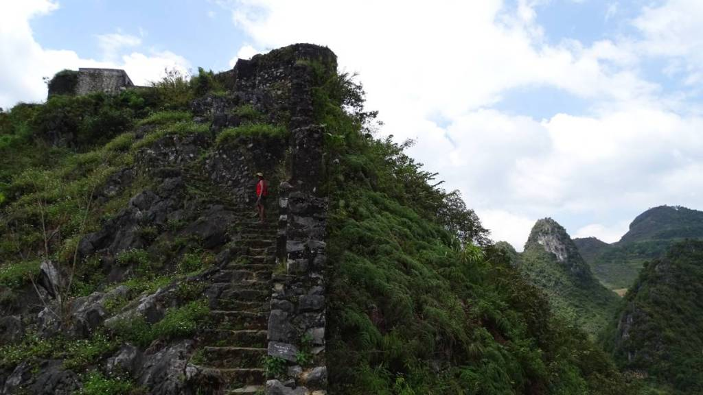 Climbing the narrow, stone steps to the ruins of the French fortress in Dong Van