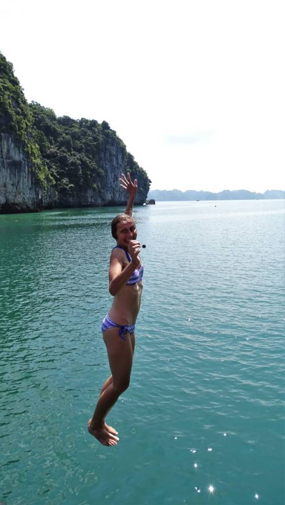 The author jumping with joy from the cruising ship straight into the turquoise waters of Ha Long Bay