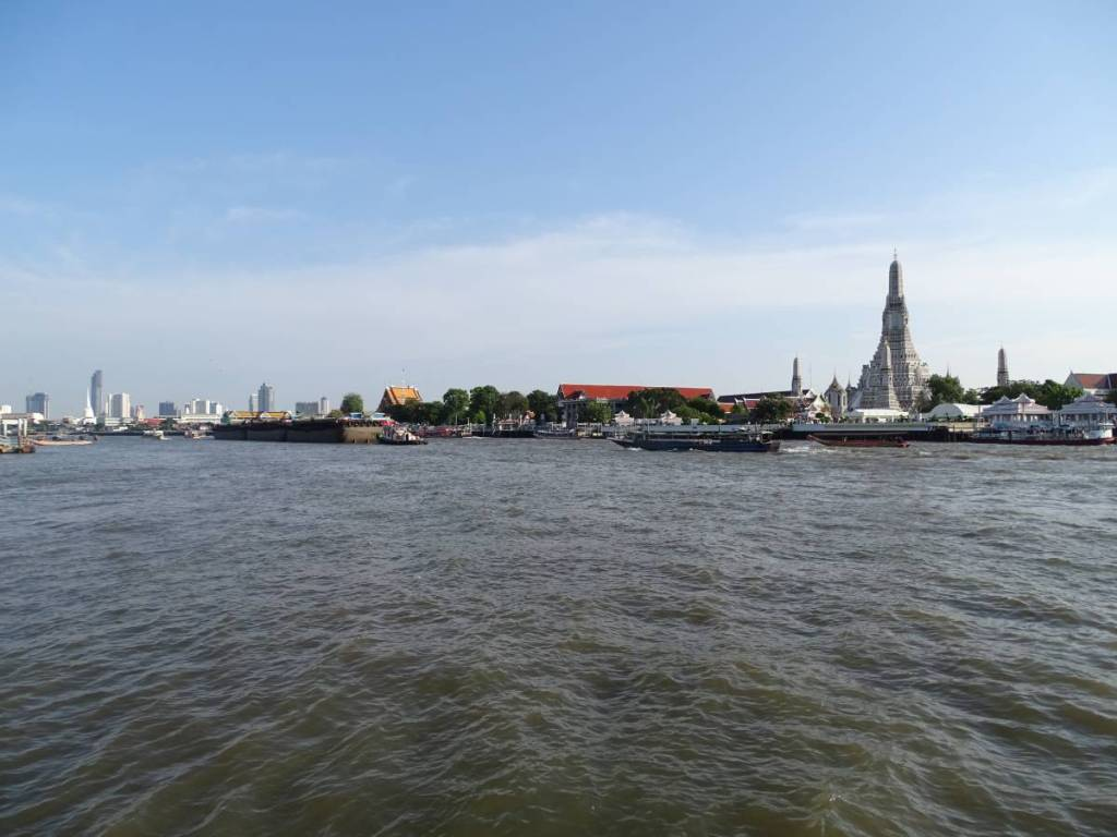 Chao Phraya river in Bangkok and Wat Arun on its far bank