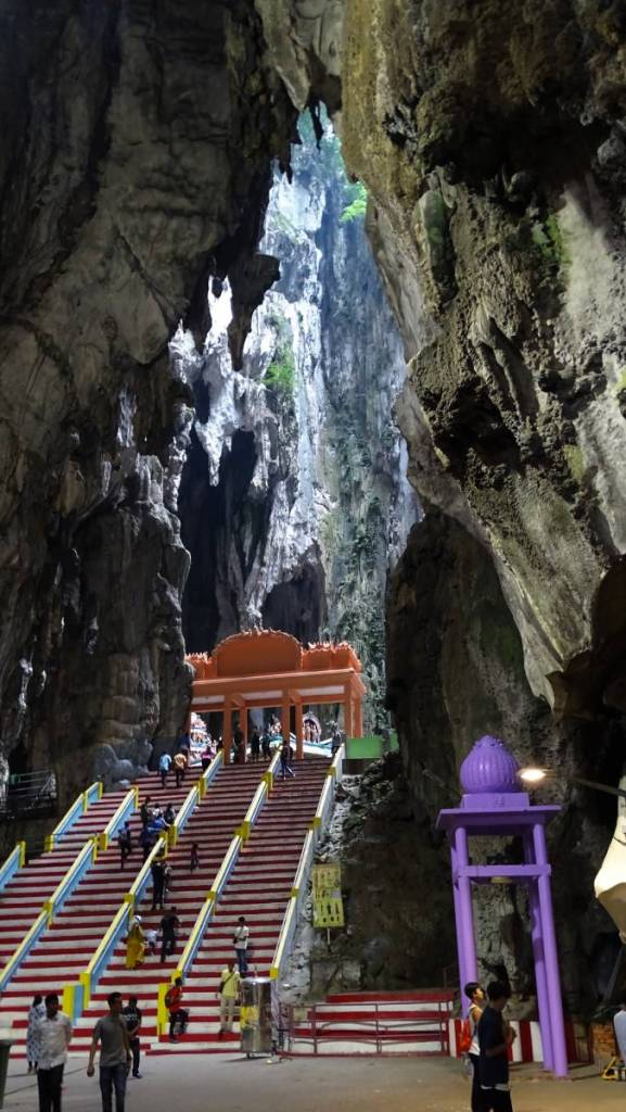 Painted fleet of stairs joining two huge caves at the Batu Caves