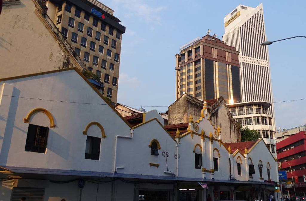 Early-20th century buildings dwarfed by the ugly high rise buildings in Kuala Lumpur China Town