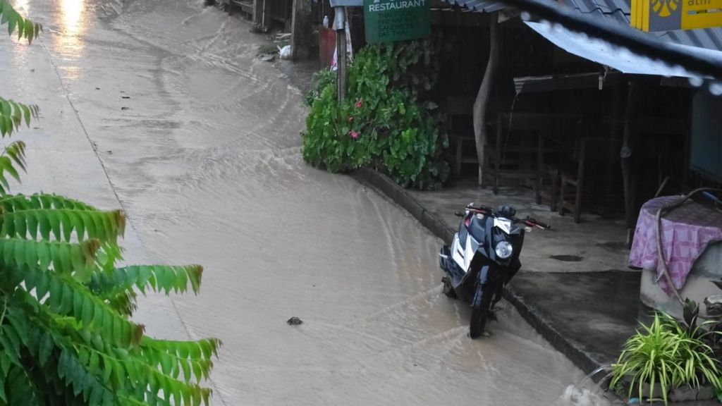 rain water flowing down the street near Sairee beach in Koh Tao