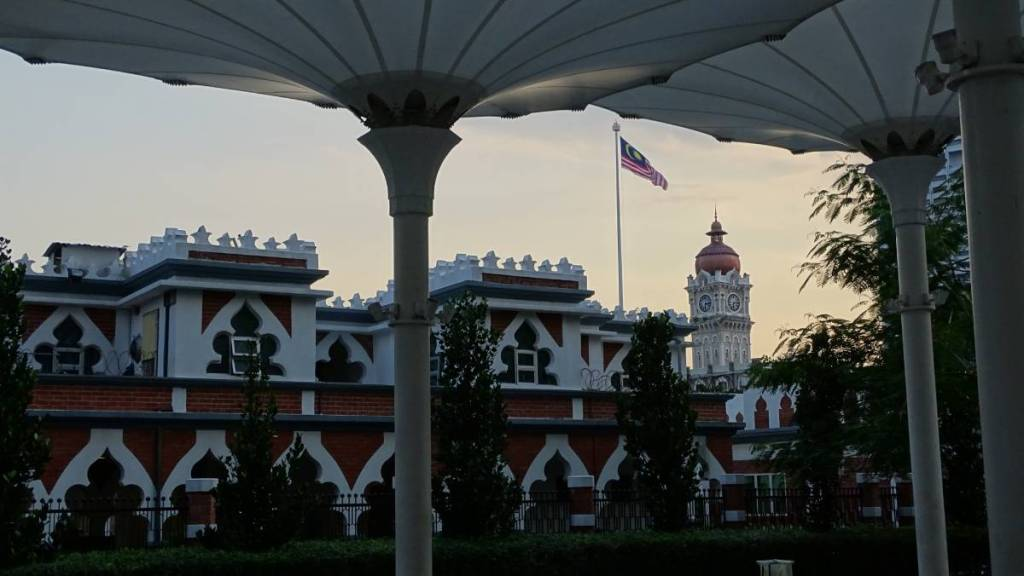 The Kuala Lumpur city centre with the Malaysian flag above the oriental style colonial buildings
