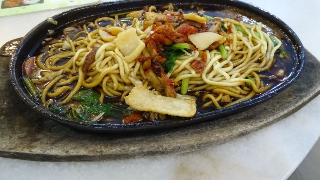 The Baba Nyonya style hot plate with noodles and tofu at a vegetarian restaurant in Malacca