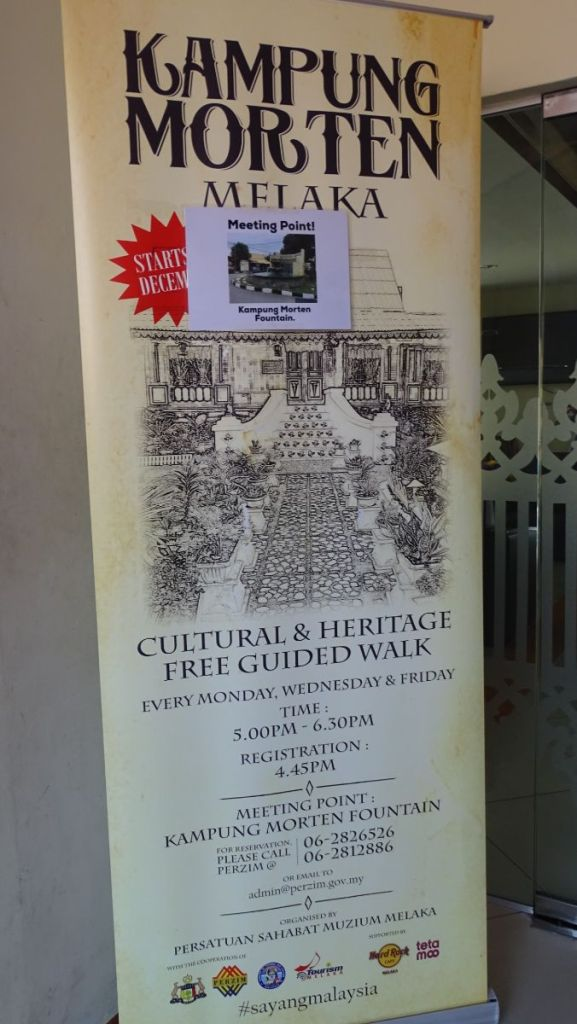 Poster advertising free guided tours of Kampung Morten area in Malacca