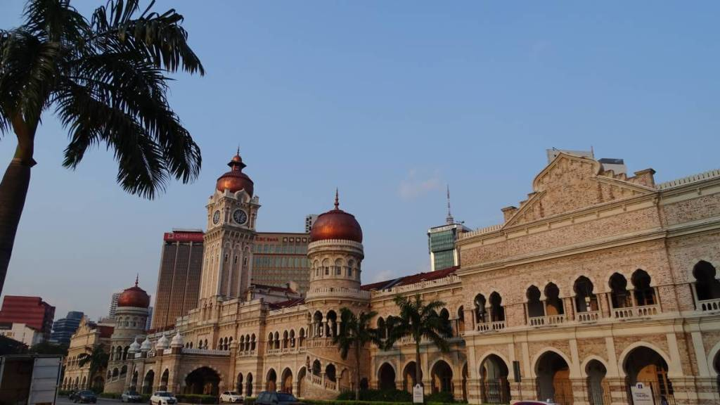 Neo-Moorish/ neo-Mughal style grand Sultan Abdul Samad Building with a clock tower, arcades, domes and arched windows standing at the Merdeka Square in Kuala Lumpur