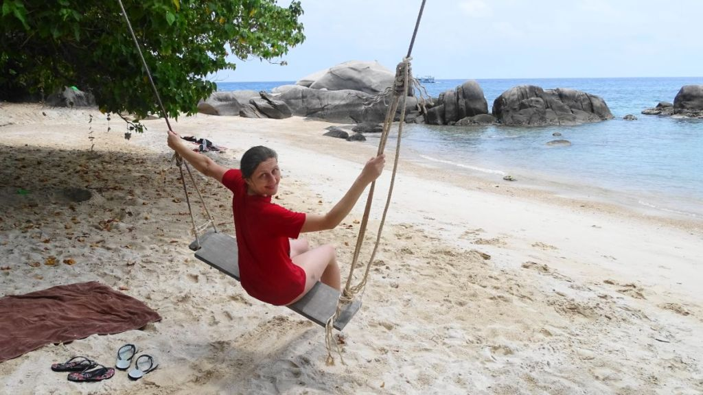 Weronika is on the swing on sandy Sai Nuan beach in Koh Tao