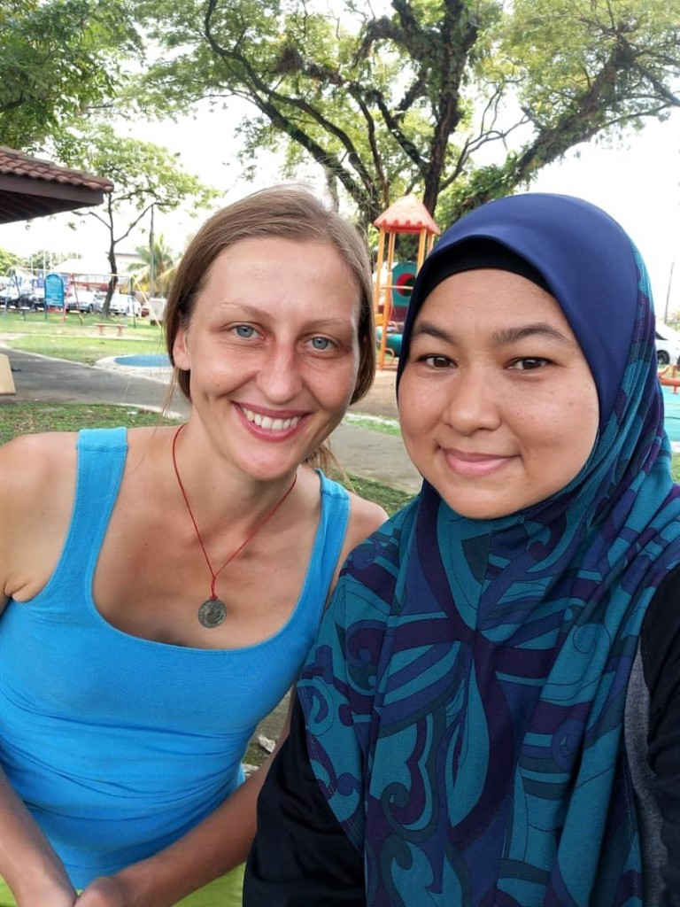 The author posing with her Malay female Couchsurfing host