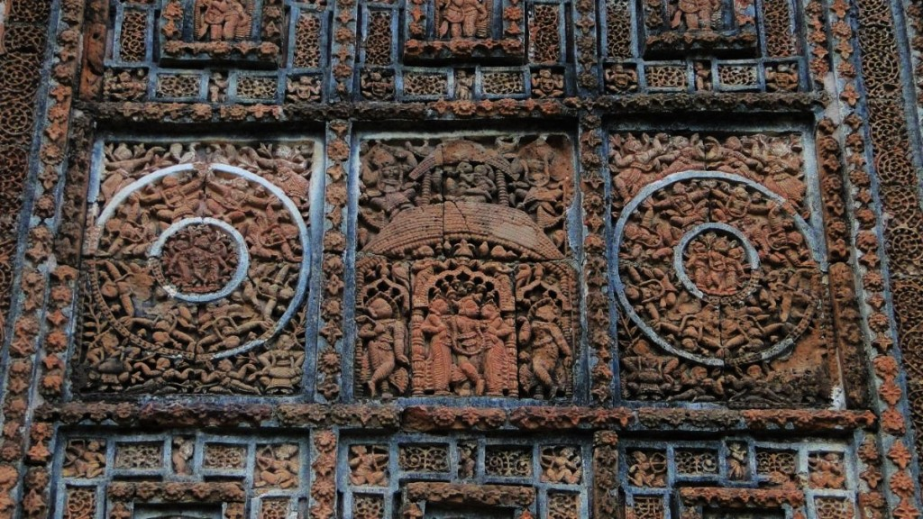 Intricately carved terraccota reliefs on the outer walls of a temple in Bhinshnupur.